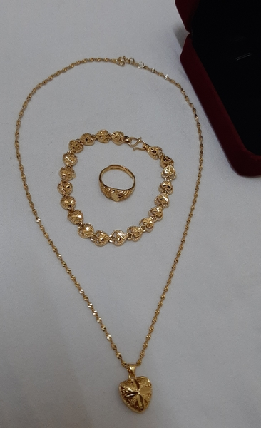Used 2 sets of heart shape gold plated chain in Dubai, UAE