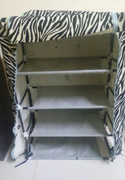Used Shoe rack with fabric covering in Dubai, UAE