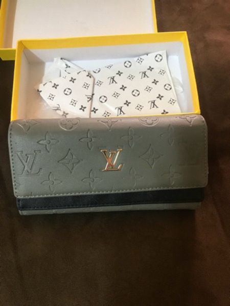 Used Gray LV wallet  in Dubai, UAE