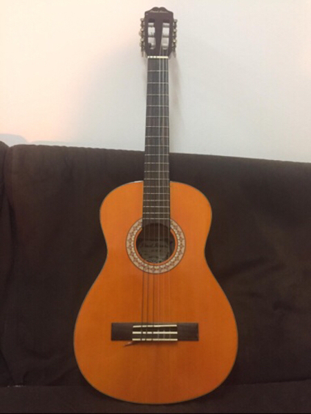 Used Acoustic guitar with free finger guards in Dubai, UAE