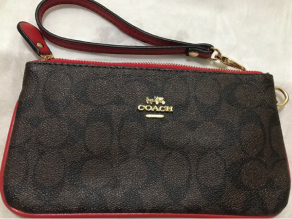 Used Coach wristlet brown/red in Dubai, UAE