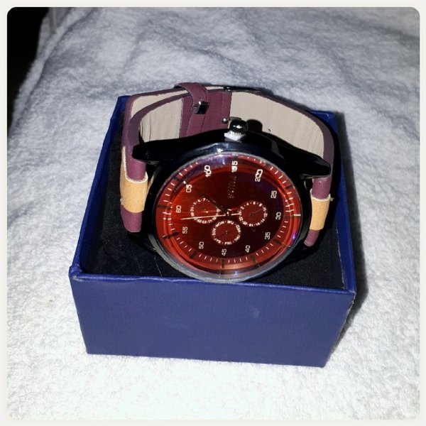 Used New watch for man maroon color in Dubai, UAE