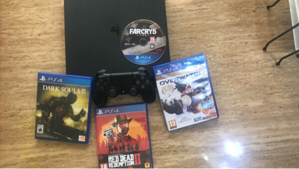 Used PS4 slim with 4 games (no controller) in Dubai, UAE