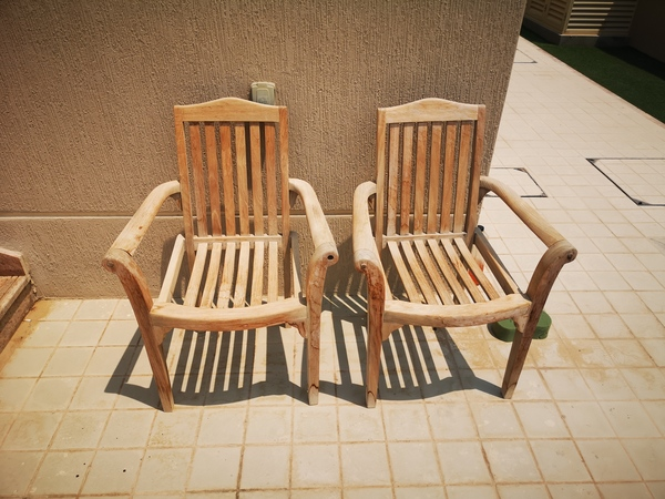 Used 2 wooden garden chairs in Dubai, UAE