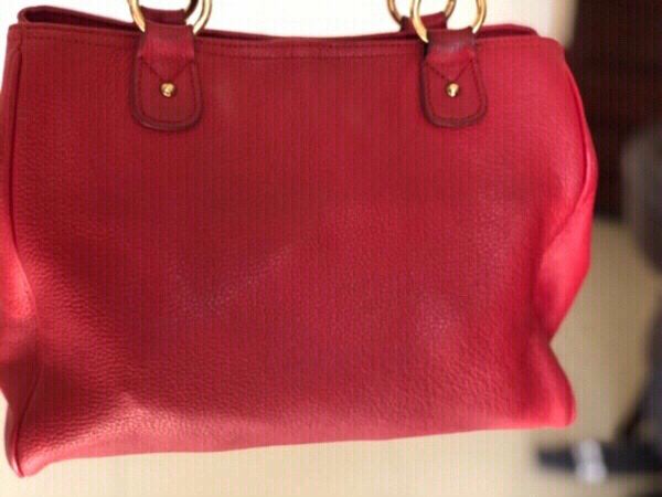 Used Tommy Hilfiger red leather bag in Dubai, UAE