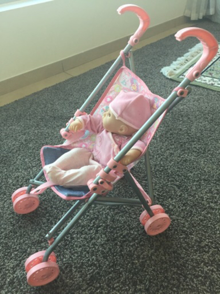 Used Baby doll with sounds and stroller in Dubai, UAE