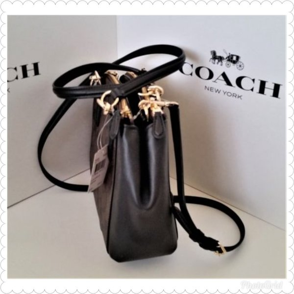 Used Authentic coach miniChristie brown black in Dubai, UAE