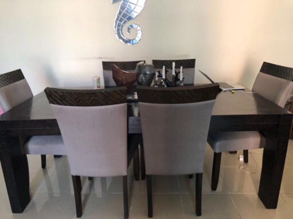 Used Six seater wooden dining table and chair in Dubai, UAE
