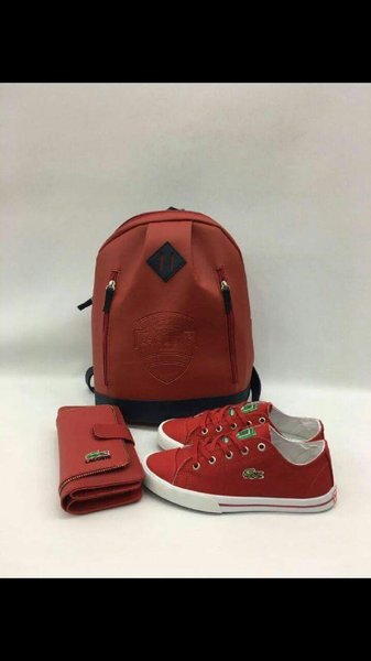 Used LACOSTE red wallet/shaker shoes New in Dubai, UAE