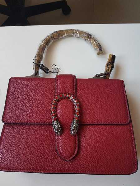 Used Red handbag NEW with extra strap in Dubai, UAE