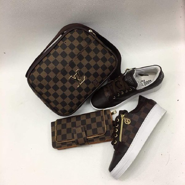 Used LV BROWN COLOR WITH SMALL BAG in Dubai, UAE