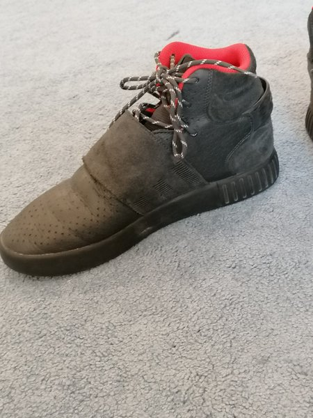 Used Red and black Adidas shoes boots in Dubai, UAE
