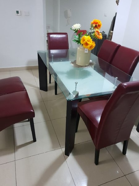 Used Glass Dining Table with 6 chairs in Dubai, UAE