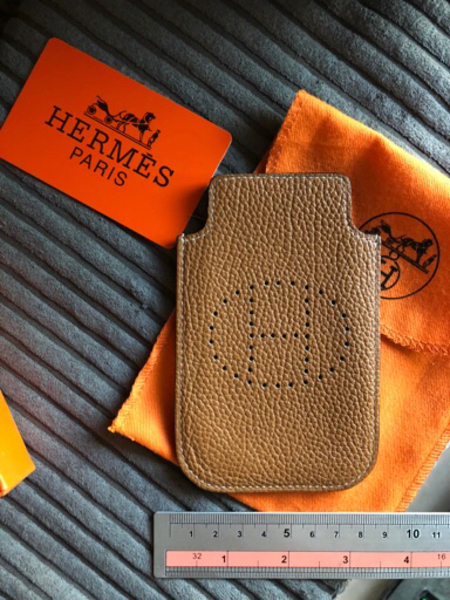 Used Hermès leather phone case/ cards holder in Dubai, UAE