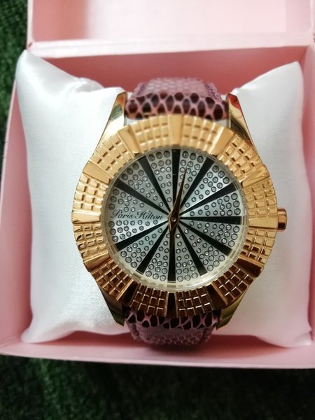 Used Paris Hilton watch purple strap in Dubai, UAE