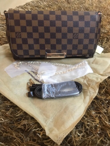 Used Grid Louis Vuitton sling bag in Dubai, UAE