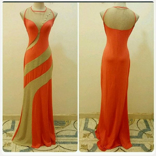 Used Brand new long dress golden orange in Dubai, UAE