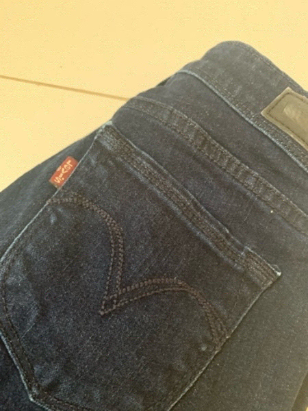 Used Levi's jeans and pink top in Dubai, UAE