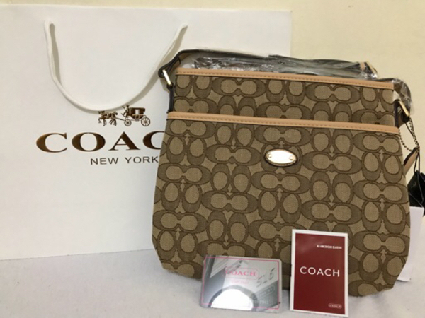 Used Coach 2 pockets - light brown in Dubai, UAE
