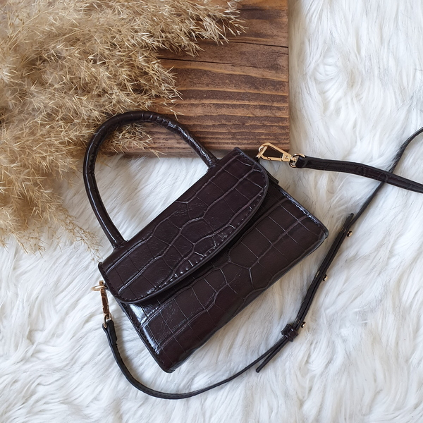 Used Dark brown mini bag in Dubai, UAE