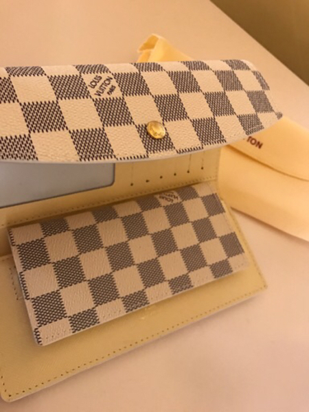 Used White grid designed LV wallet for Her  in Dubai, UAE