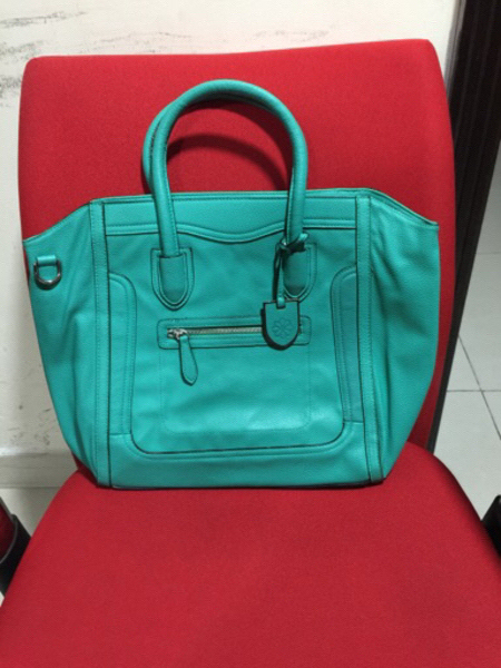 Used Bag green color preloved  in Dubai, UAE
