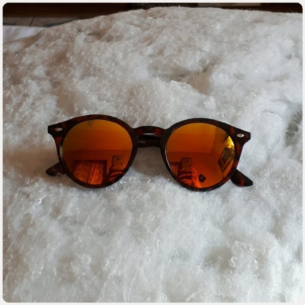 Used Sungglass for girl shiny brown in Dubai, UAE