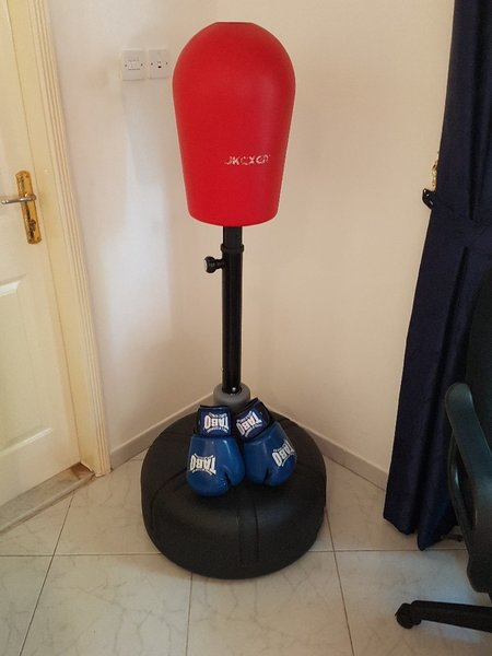 Used Boxing stand + boxing gloves in Dubai, UAE