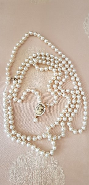 Used ADORE pearls long necklace with Cameo in Dubai, UAE