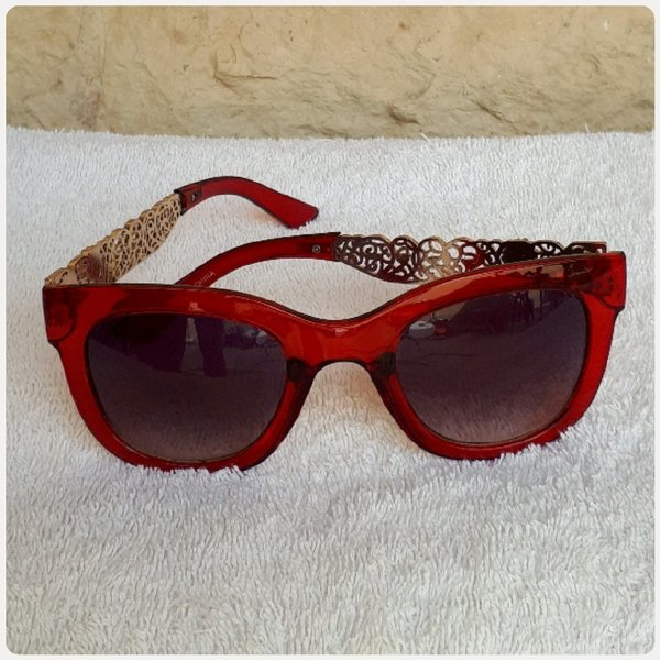 Used Red sungglass with metals.. in Dubai, UAE