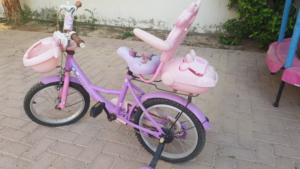 Used Girls bicycle with training wheels in Dubai, UAE