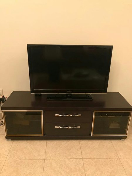 Used Tv and tv stand in Dubai, UAE