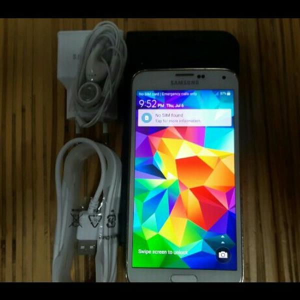 Used Samsung S5 With Original Charger Data Cable And Headphones. Condition 10/10.  in Dubai, UAE
