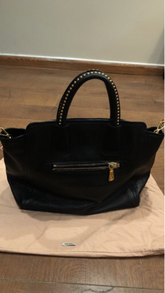 Used Large Genuine black Leather miu miu bag in Dubai, UAE