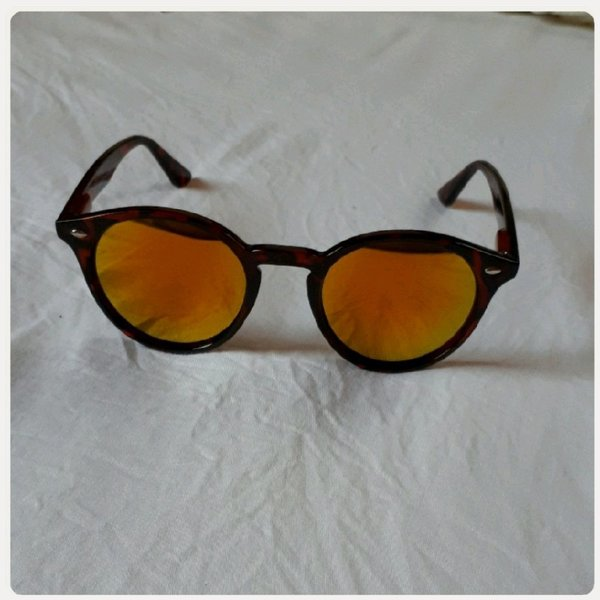 Used Sungglass brown small in Dubai, UAE
