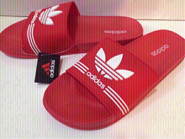 Used Adidas slippers size 43 in Dubai, UAE