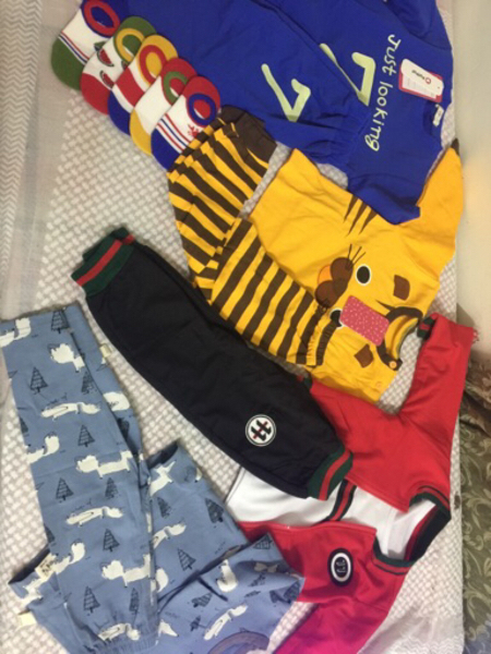 Used Kids 8 tops and pants 1pullover 1sock in Dubai, UAE