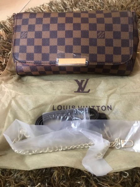 Used Brown Louis Vuitton sling grid 💼  in Dubai, UAE