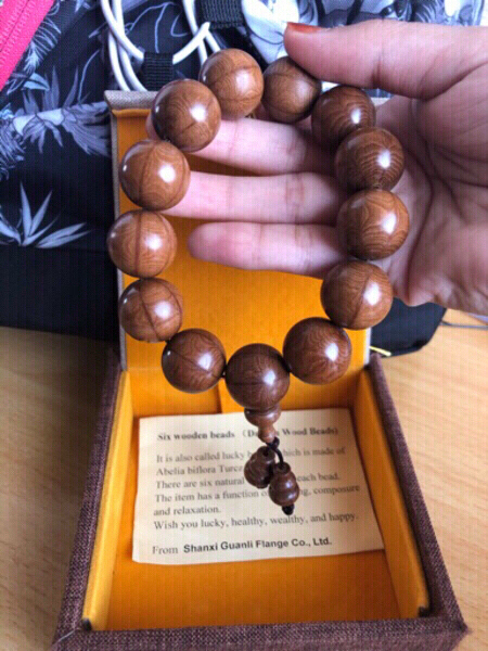 Used 6 dragon wooden lucky beads, from China in Dubai, UAE