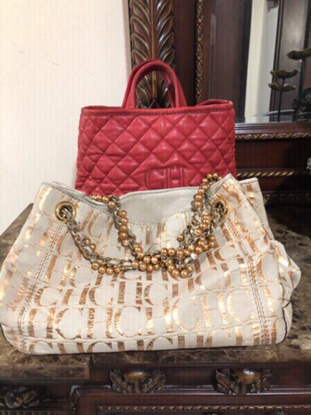 Used Two Carolina Herrera hand bags in Dubai, UAE
