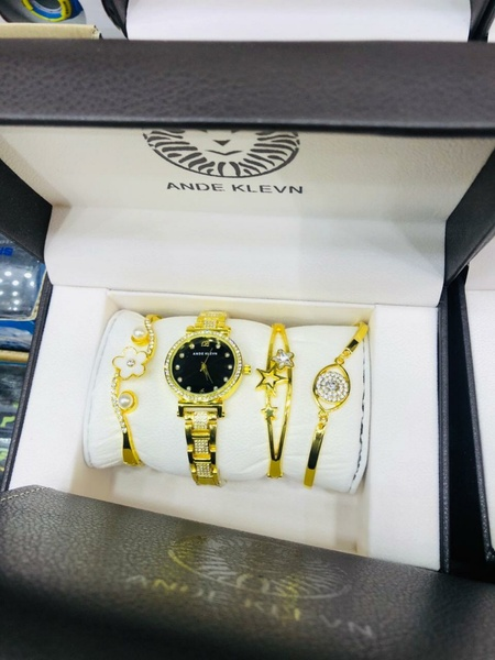 Used Watch and 3 bracelets gold color in Dubai, UAE