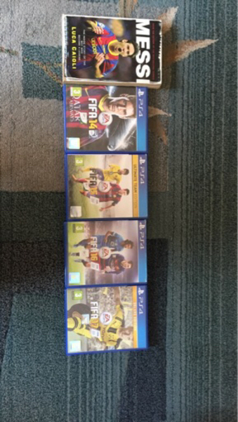 Used FIFA 10-17 PS4 collection with book  in Dubai, UAE