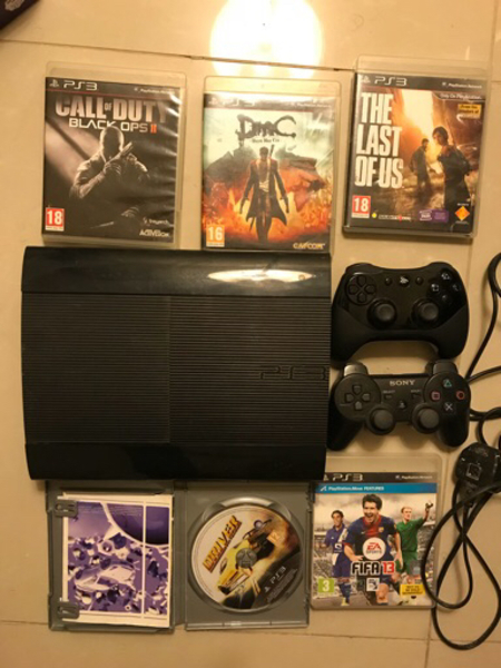 Used Playstation 3 + 2 controllers with games in Dubai, UAE