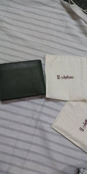 Used wallet (antique green )pure leather in Dubai, UAE