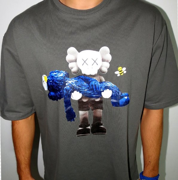 Used T shirt Kaws print (Brand new) in Dubai, UAE