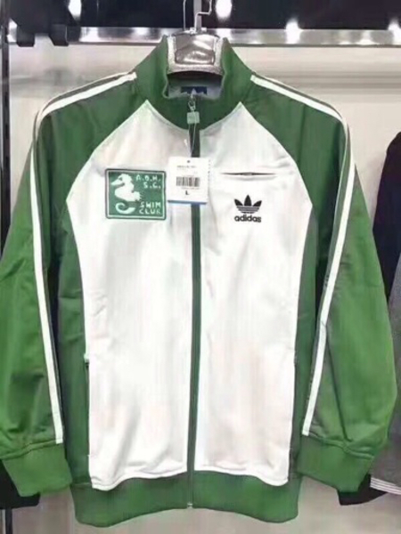 Used Adidas green white combo athletic jacket in Dubai, UAE