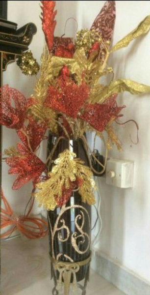 Used vase with flowers and brass stand in Dubai, UAE
