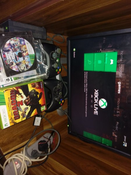 Used Xbox 360 with 9 games in Dubai, UAE