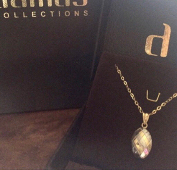 Used Damas 18K Gold Pendant with chain. in Dubai, UAE