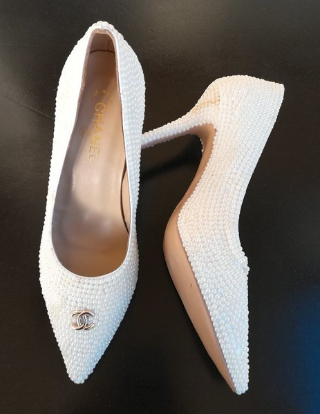 Used Channel Shoes  and White Hand Bag in Dubai, UAE